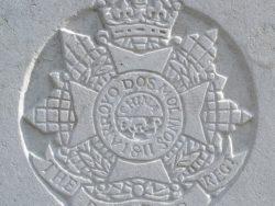 Capbadge of the Border Regiment on headstone