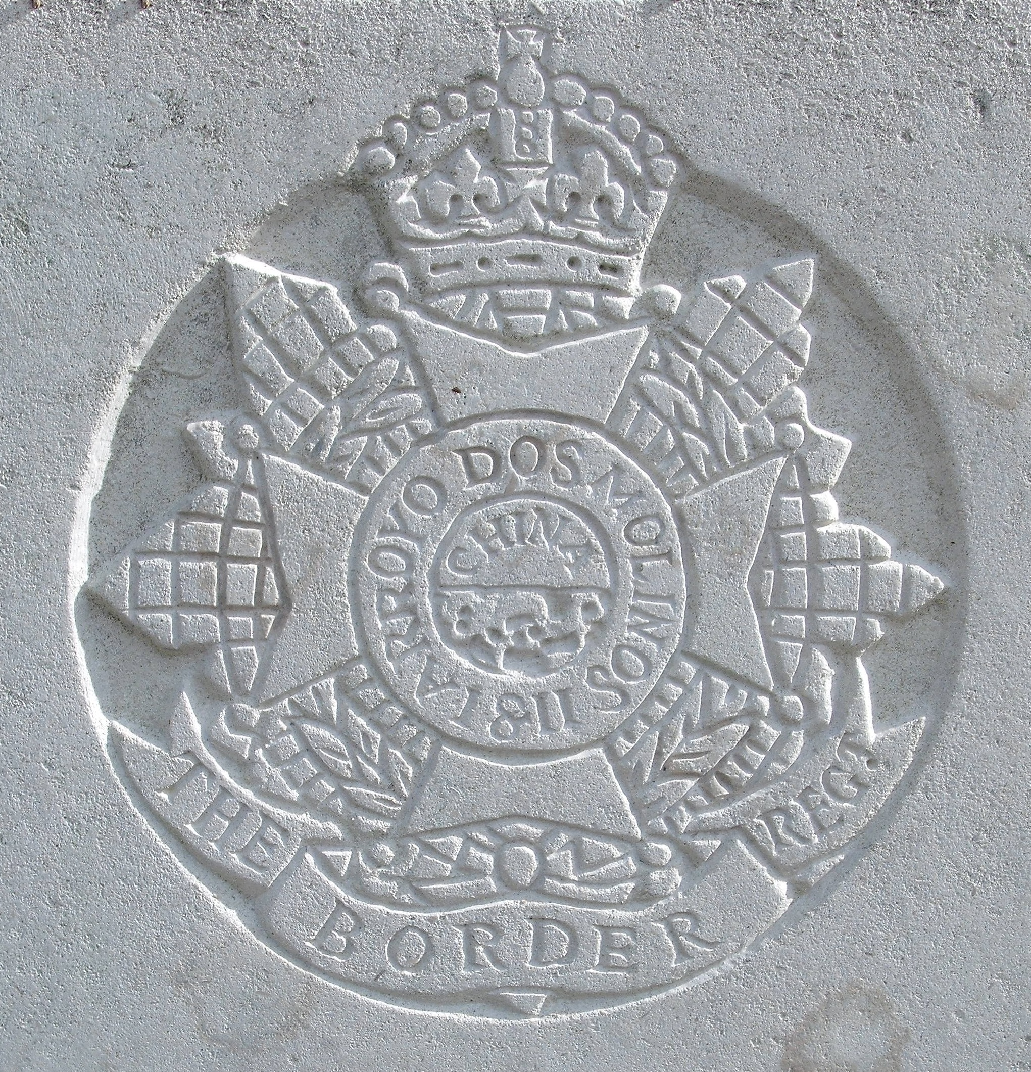 Capbadge of the Border Regiment on headstone